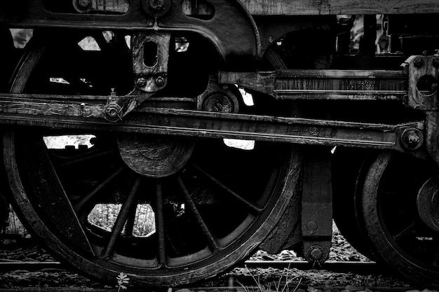 Old steam locomotive wheel and rods - monochrome