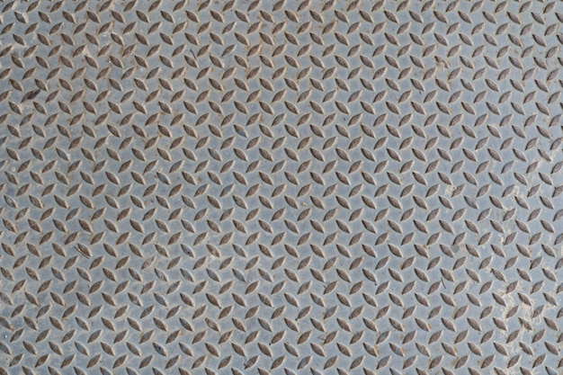 Old steel metal floor plate with diamond pattern texture background