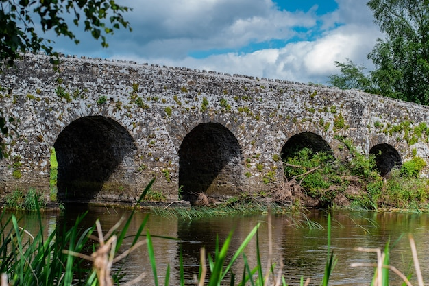 Old stone arch bridge over a river in count meath ireland