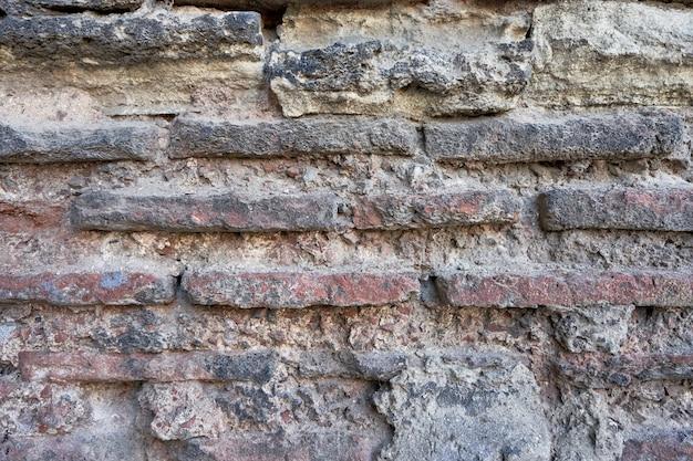 古い石レンガの壁のテクスチャがクローズアップ。