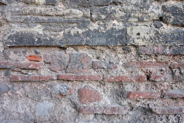 Старая текстура стены каменного кирпича.