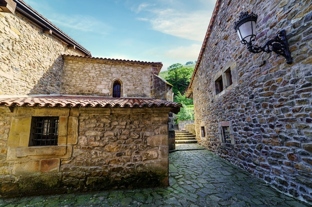 Old stone houses and narrow alley in mountain village