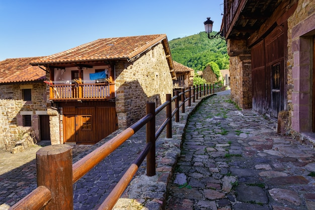 Old stone houses with wooden fencing in the streets
