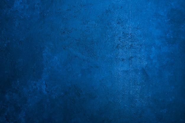 Old stone texture background toned classic blue color