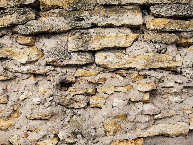 色石のクローズアップ背景テクスチャの古い石壁