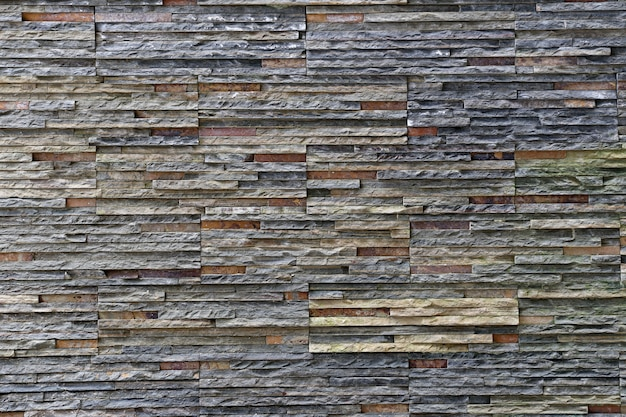 Old stone wall texture in weathered and have natural surfaces.