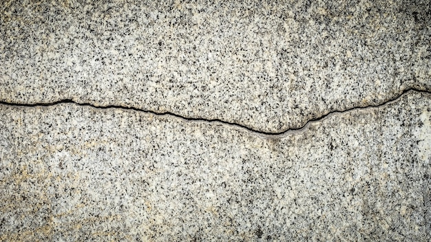 Old stone wall with a crack. texture for design