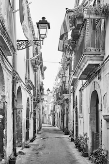Old street in the old city in syracuse, sicily island, italy. black and white