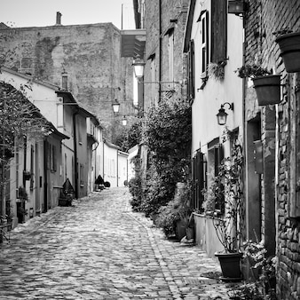 Old street in santarcangelo di romagna town, rimini province, italy. black and white photography