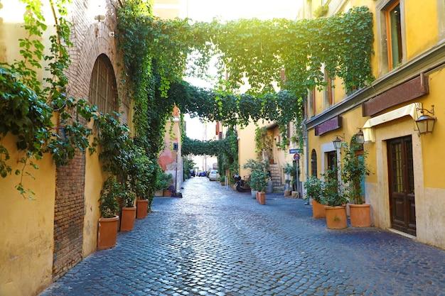 Old street in trastevere, rome, italy