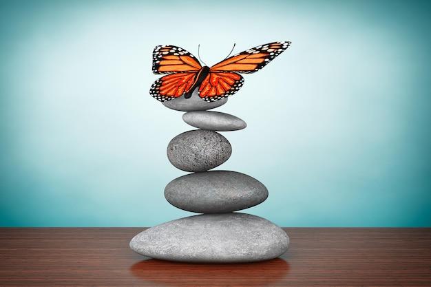 古いスタイルの写真。テーブルの上の蝶とバランスの取れた石