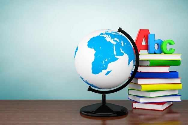 Фото старого стиля. книги со знаком abc и глобус рабочего стола мира на столе