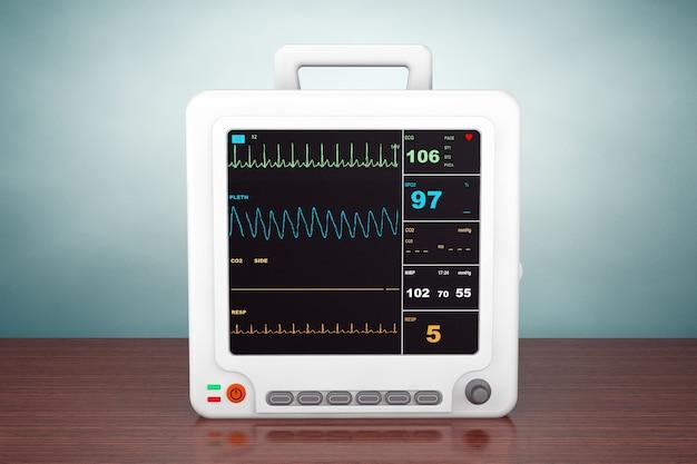 古いスタイルの写真。テーブルの上のヘルスケア携帯型心臓モニタリング機器