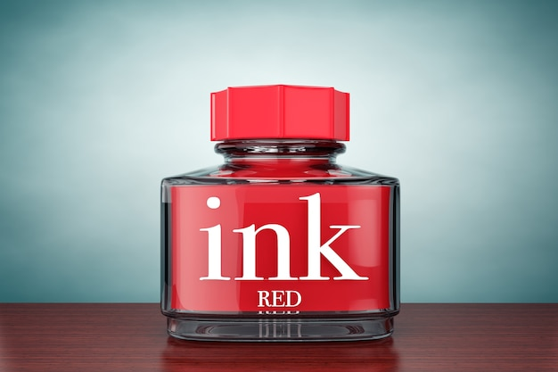 Old style photo. red ink bottle on the table