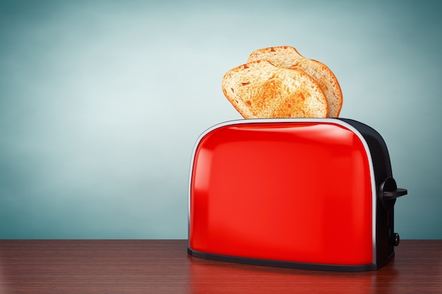 올드 스타일 사진. 테이블 위의 빈티지 레드 토스터에서 토스트가 튀어나옵니다.