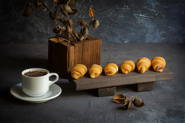 Old style still life with croissants and a cup of coffee