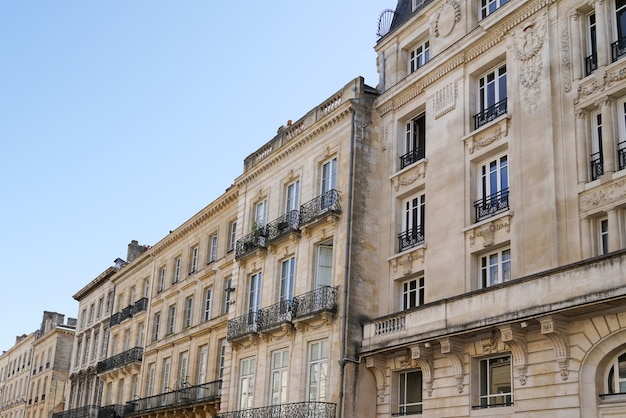 Old and stylish haussmann building facades in bordeau
