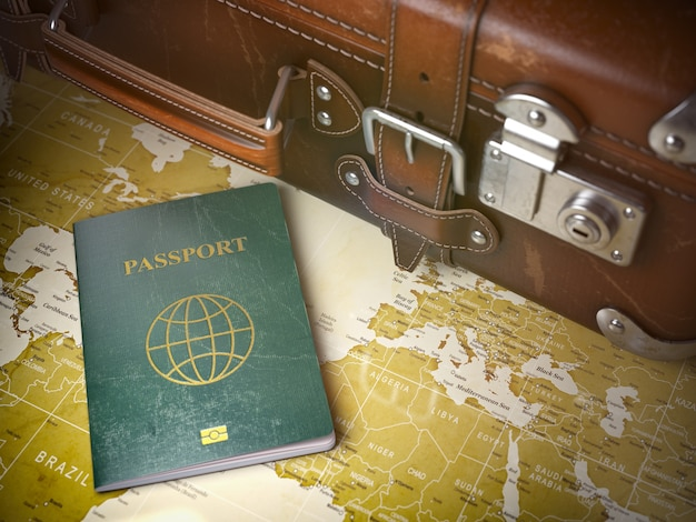 Old  suitcase with passport on the world map