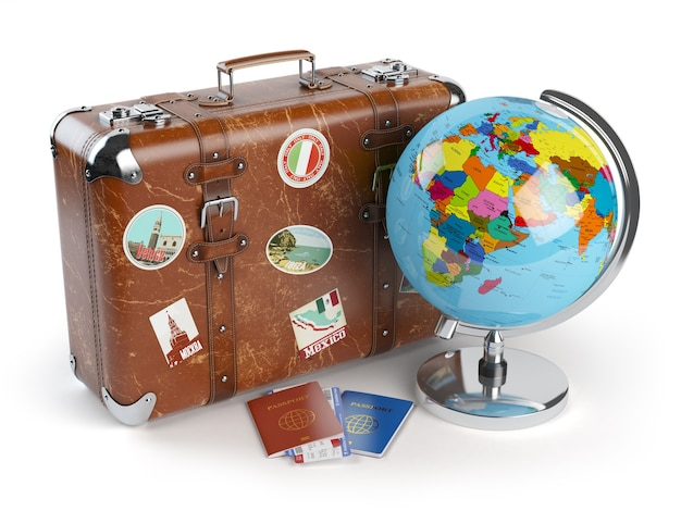 Old suitcase with stickers globe and passports with boarding pass tickets