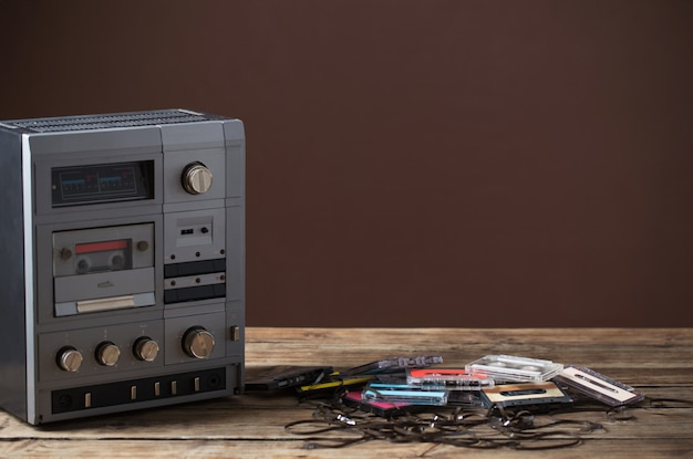 Old tape recorder and cassette on  wooden table