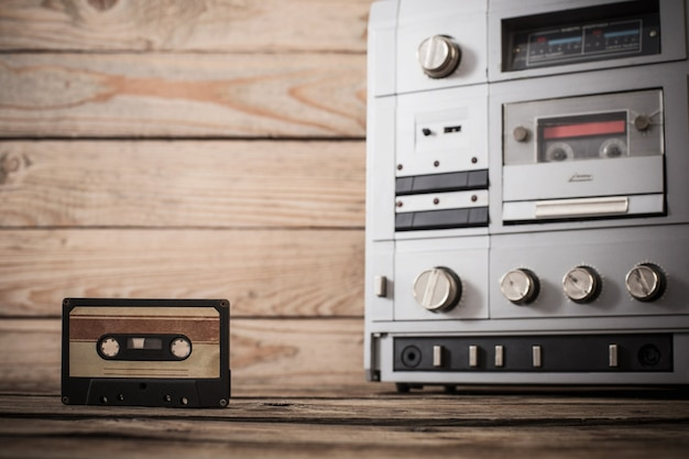 Old tape recorder and cassette on wooden
