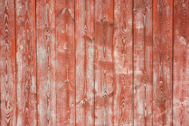 Old taped wooden background, with red paint, scratched old background