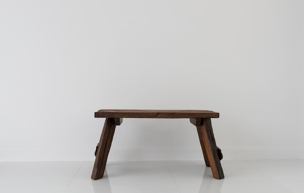 Old teak wood chair in white room interior
