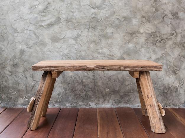Old teak wood chair on wooden floor