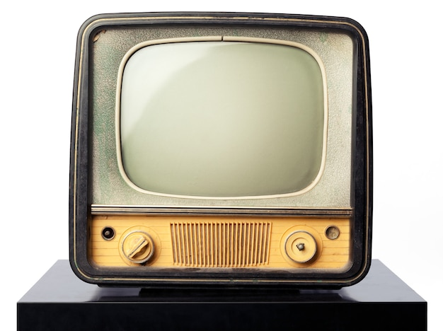 An old television standing on a black table on white background