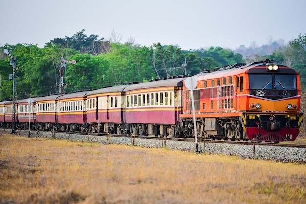 Old thai-style trains that can still pick-up passengers on the train tracks