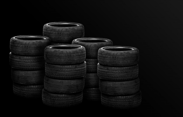 Old tires stacked, isolated on black