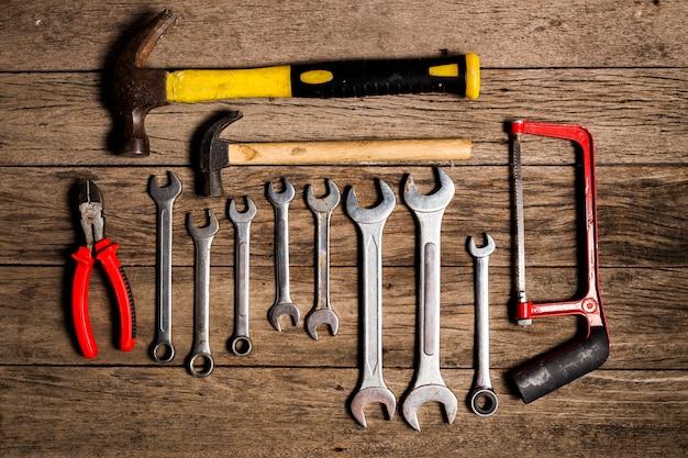 Old tool renovation on grunge wood