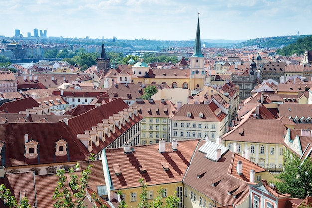 Old town cityscape of praha with red roofs in summer