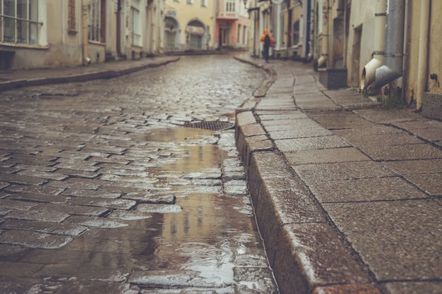Old town pavement street on rainy day