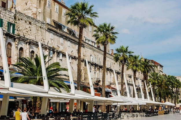 Old town of split, medieval city with streets full of tourists and religious buildings.