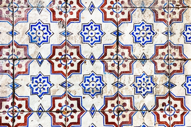 Old traditional portuguese decorative tile azulejos. shabby surface of ceramic tile. lisbon, portugal. abstract background.