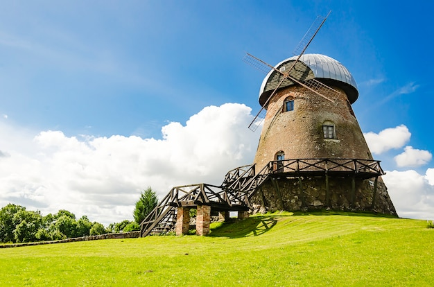 An old traditional windmill with wooden sails