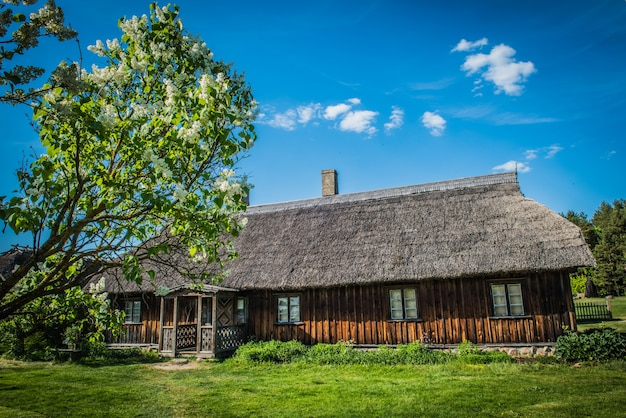 Old traditional wooden house in ethnographic open air village in riga, latvia