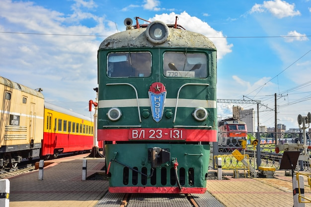 Old train at the museum of trains, green old train at the station