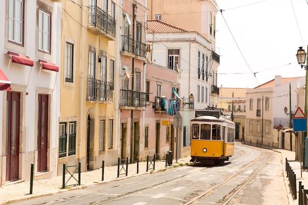 Old tram on narrow european street