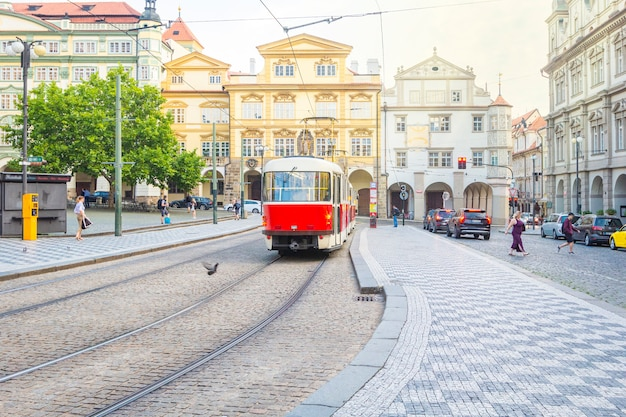 Old trams on main square of prague's mala strana next to st. nicholas church, prague, czech republic