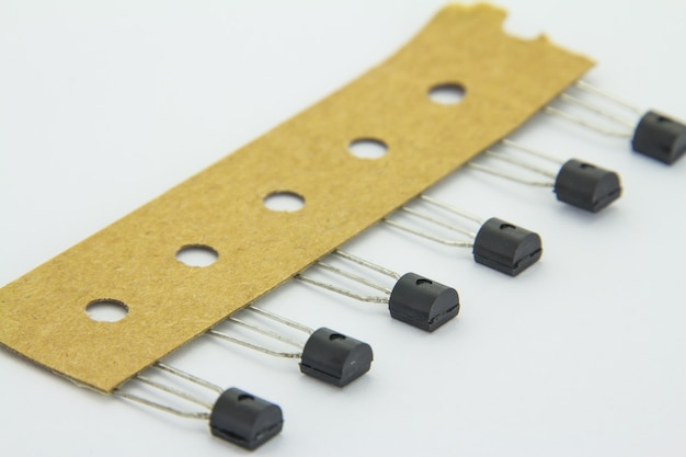 The old transistors with reel package on the white background