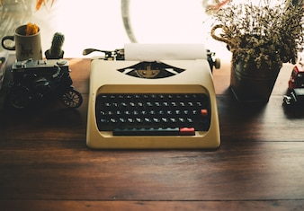 Old typewriter on old wooden table