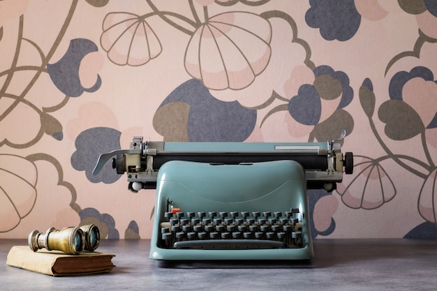 Old typewriter on vintage background