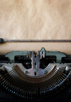 Old typewriter on vintage paper