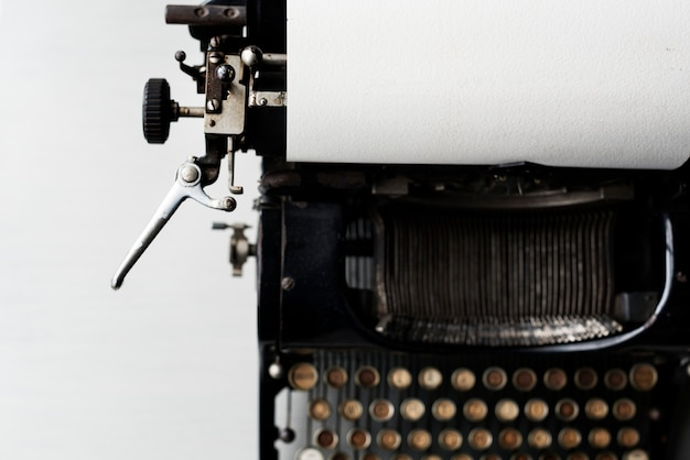 Old typewriter on white tabletop
