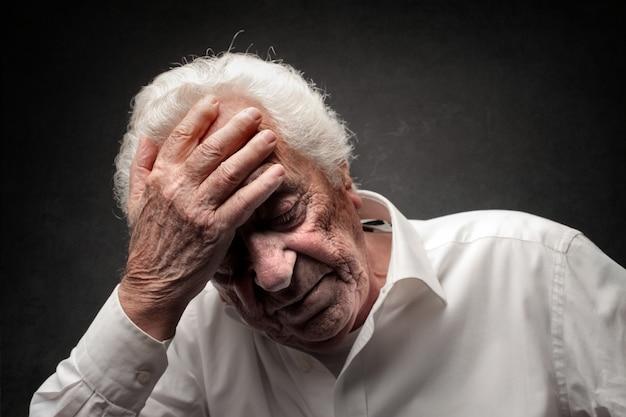 Old unhappy man