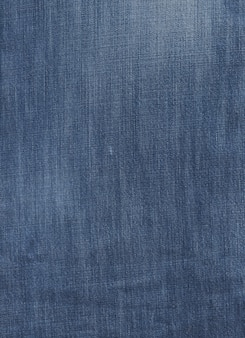 Old used blue denim texture close up background