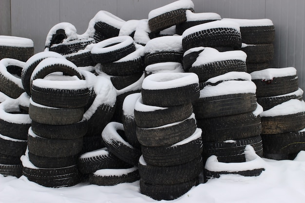 Old and used car tires in the winter