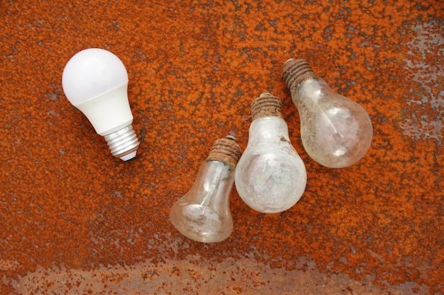 Old used light bulbs on a rusty metal surface